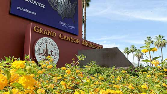 gcu campus entrance with flowers